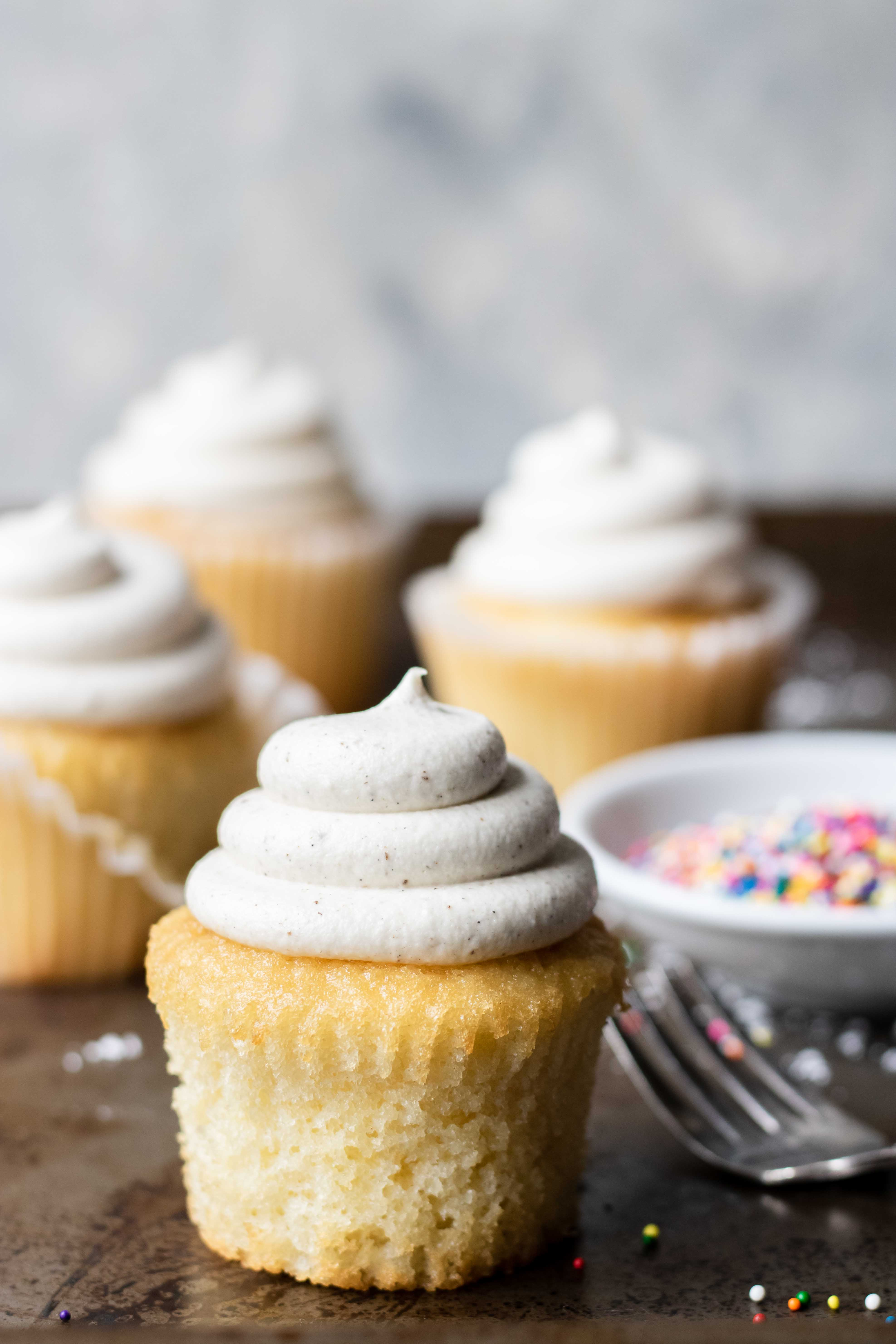 Vanilla Cupcakes with Vanilla Frosting and sprinkles on the side - food photography